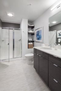 Bathrooms at The Carter offer a luxurious space with extra shelving, and a stand-up shower in select units!