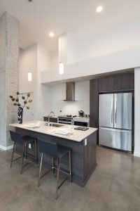 With vaulted ceilings, an island kitchen, and thoughtful design touches, our Live Work Units provide a truly urban vibe!